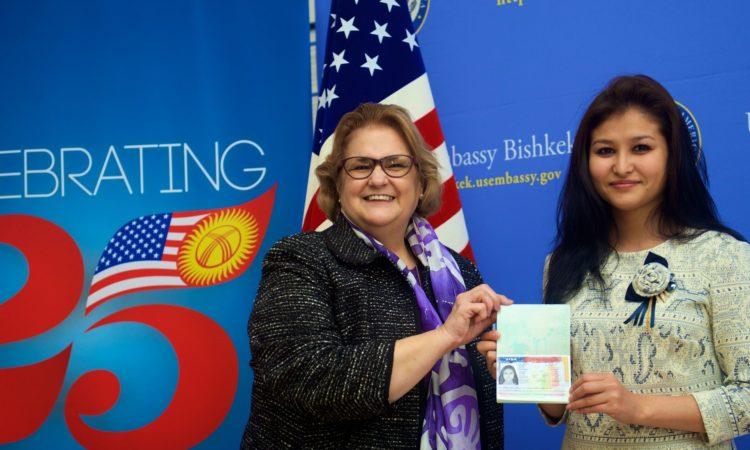 Ambassador Sheila Gwaltney Presents First U.S. Immigrant Visa in Bishkek